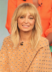 Nicole Richie wore her layered locks with very subtle waves and long choppy bangs at the 2012 Winter TCA Tour.