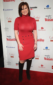 Caroline Manzo's red dress and black knee-high boots at the 2012 Red Dress Awards were a super-stylish retro pairing.