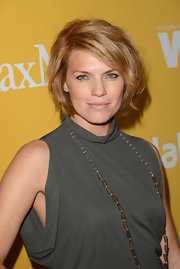 Kathleen Rose Perkins attended the 2012 Crystal + Lucy Awards. She stuck to neutral tones for her makeup, with soft beige lips completing the look. The result was a fresh and natural appearance for the actress.