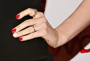 A bright white accent nail made Anne Hathaway's rich red mani ultra-playful.
