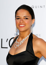 Michelle Rodriguez accessorized with a stunning diamond statement necklace when she attended the 2012 amfAR Gala.