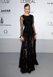Lindsey Wixson arrived at the 2012 amfAR's Cinema Against AIDS in a shimmering black gown featuring sheer lace black sleeves.