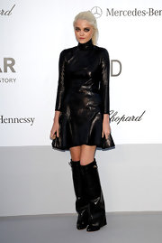 Sky Ferreira arrived at the amfAR Gala wearing loose black leather boots with her black leather A-line dress.