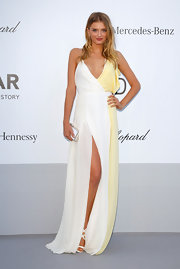 Lily Donaldson brought a summery air to the amfAR event in her white and yellow dress.