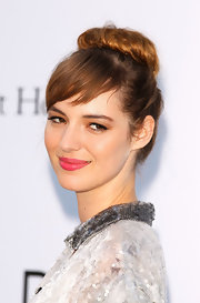 Louise Bourgoin perfected her pout with a juicy watermelon shade of lipstick.
