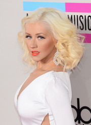 Christina Aguilera was flawlessly made up with a bright coral lip color and shimmery eyeshadow.