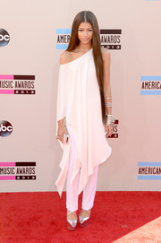 Zendaya Coleman chose a flowy white handkerchief-hem tunic and matching pants by Donna Karan for her American Music Awards red carpet look.