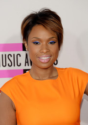 Jennifer Hudson was in the mood for color, wearing bright blue eyeshadow to complement her orange dress.