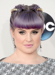 Kelly Osbourne sported a whimsical braided updo with blunt bangs at the American Music Awards.
