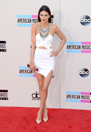 Kendall Jenner cut a super-slim silhouette in her asymmetrical white mini skirt and crop-top combo by Keepsake.