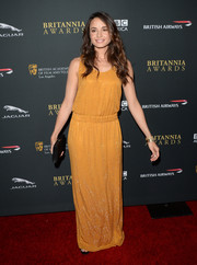 Mia Maestro went for subtle sparkle in a mustard Gucci evening dress during the BAFTA LA Britannia Awards.