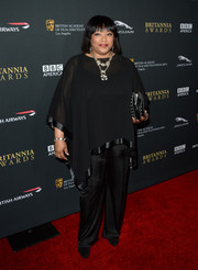 Zindzi Mandela teamed her blouse with a pair of black silk pants for an elegant finish.