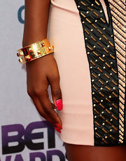 Coco Jones' accessory of choice was a lone gold cuff to accentuate the gold beading in her dress at the BET awards.