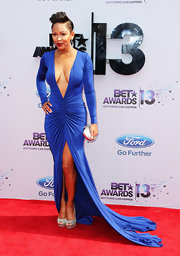 Megan Good took the plunge on the red carpet when she donned this electric blue long-sleeve dress with a flowing fishtail train.