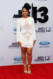 Ashanti's long-sleeve white lace frock looked fun and flirty on the singer.