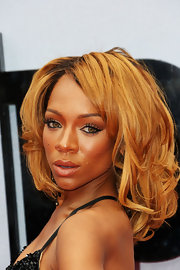 Lil Mama showed off her golden strawberry locks with a thick, wavy 'do.