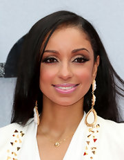 Mya opted for a sleek red carpet look, which she topped off with a side-parted straight 'do.