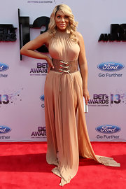 Tamar Braxton opted for a desert sand evening gown with a bold corseted belt.