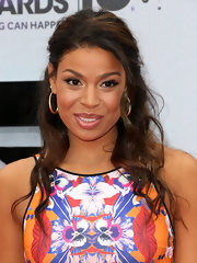 Jordin Sparks pulled back her chocolate waves into a half updo to open up her whole look.