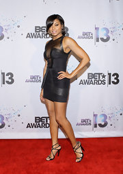 Taraji stunned at the 2013 BET Awards where she wore a black silk dress with sheer paneling and leather detailing.