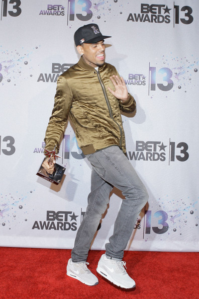 Chris Brown playfully posed for the photographers in a pair of faded skinny jeans.
