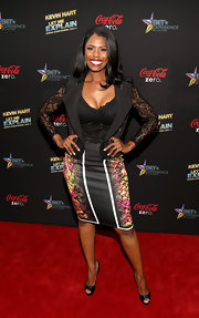 Omarosa chose a patterned pencil skirt to pair with her lace blouse and blazer for a sexy and sophisticated look.