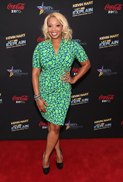 Chef Huda sported a green and blue patterned frock for a bold red carpet look.