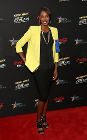 Lisa Leslie chose a sunshine yellow blazer to pair over her black ensemble.