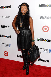 Melanie Fiona looked like an edgy schoolgirl in this black leather shirtdress when she attended the Billboard Women in Music event.
