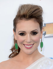 Alyssa Milano opted for a hair look that defied gravity when she rocked this ponytail pompadour.
