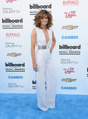 Stana Katic rocked a sleek V-neck white and silver jumpsuit at the 2013 Billboard Music Awards.