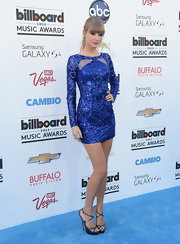 Taylor Swift's long-sleeve beaded frock had a totally glamorous and electric feel to it at the 2013 Billboard Music Awards.