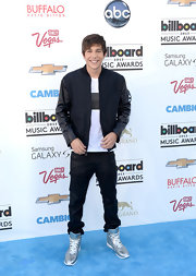 Austin Mahone kept his look casual and hip with this zip-up jacket that featured leather sleeves.