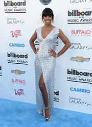 Kelly Rowland rocked a futuristic look at the 2013 Billboard Music Awards when she wore this silver embellished evening dress.