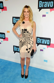 Taylor Armstrong chose a sheer nude dress with beaded floral embellishments for her look at the 2013 Bravo New York Upfront event.