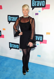 Tabatha Coffey paired an A-line skirt with a sheer loose blouse for a fun retro-style look.