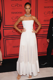 Joan Smalls showed off her toned arms in this strapless white gown that featured a corseted bodice and a sheer lace skirt.