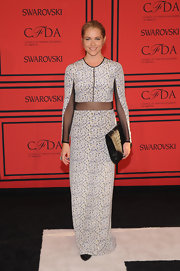 Teresa Palmer wore this modern delicate print dress that featured black mesh paneling on the sleeves and midriff.