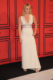 Lindsey Vonn kept it simple and sleek in this sleeveless white gown that featured a plunging neckline and embroidery at the waist.