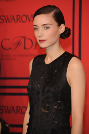 Rooney Mara may have stuck to her signature sleek bun, but she changed it up just a bit with a deep side part and a twisted knot.