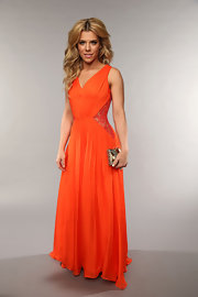 Kimberly Perry opted for a bold pop of color with this tangerine orange chiffon V-neck gown.