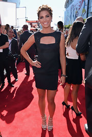 Alex Morgan rocked a deep navy dress with an embellished bodice and a cutout detail.