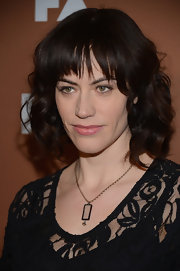 Maggie Siff wore a chain necklace with rectangular pendant at the FX Upfront Bowling event.