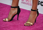 Emayatzy Corinealdi kept her look classic and sophisticated with black strappy sandals with metallic silver embellishment.