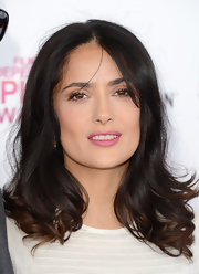 Salma Hayek's chocolate locks had a hint of a wave, giving the star's look more texture and bounce.