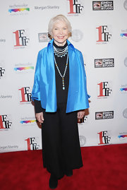 Ellen Burstyn added a pop of playful color to her red carpet look with this baby blue evening coat.