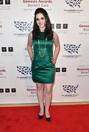 Vanessa Marano chose an emerald green cocktail dress for her sleek and sophisticated red carpet look at the 2013 Genesis Awards Gala.