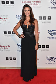 Katie Cleary chose a black column-style, strapless dress for her sexy red carpet look at the 2013 Genesis Awards Benefit Gala.