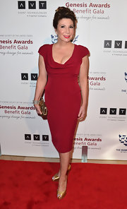 Ana Garcia chose a deep red cocktail dress with a plunging neck.