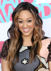 Tia Mowry styled her hair in edgy-glam waves for the HALO Awards.